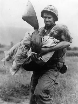 Marine Carries Woman | Vietnam War