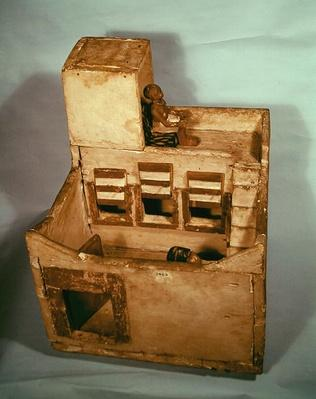 Wooden model of a granary with figures, c.2000-1800 BC