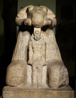 Statue of Amun in the form of a ram protecting King Taharqa, 690-664 BC