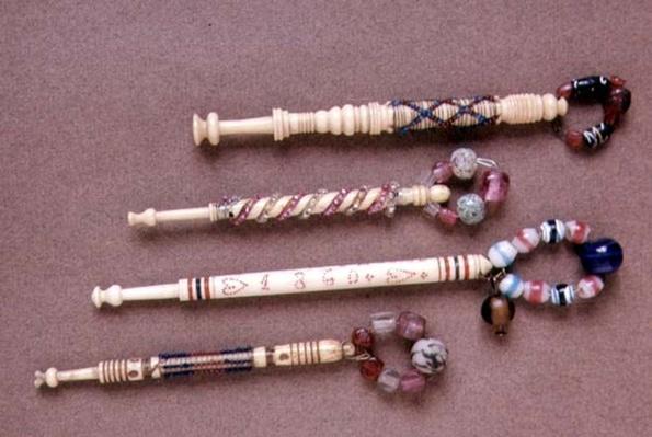 Four beaded bobbins, English, late 19th century