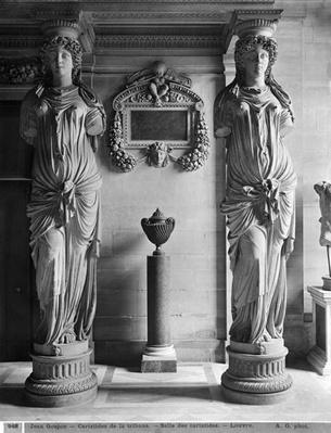 View of two caryatids from the Caryatids' Tribune in the Louvre Museum, late 19th century