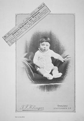Photograph of Adolf Hitler as a baby with notice of his birth in a local paper from 'A Pictorial Life of Hitler', Berlin, 1935