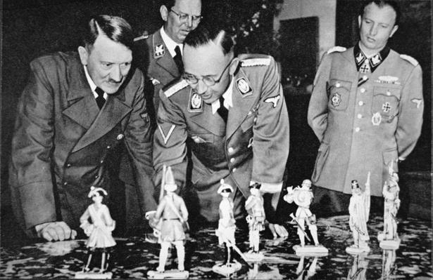 Hitler and Himmler inspecting some Meissen porcelain military figurines