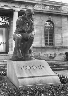 Statue of the Thinker on Auguste Rodin's tomb in the park of Villa des Brillants