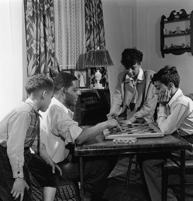 Black Family Playing Checkers at Home | African-American History
