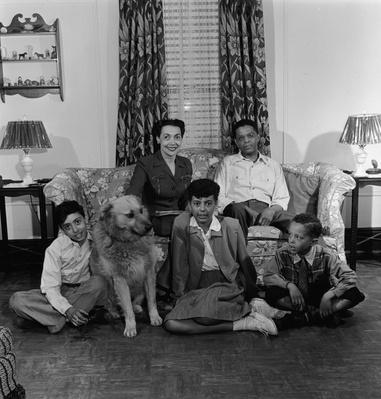 Portrait of Black Family With Dog at Home | African-American History