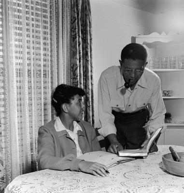 Father Helping Girl With Homework  | African-American History