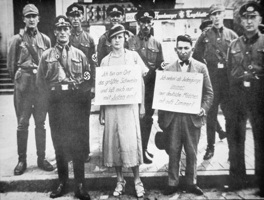 A Jewish man and a non-Jewish woman pilloried by Nazi officers, presumably for an alleged involvement, Cuxhaven, Germany, July 1933