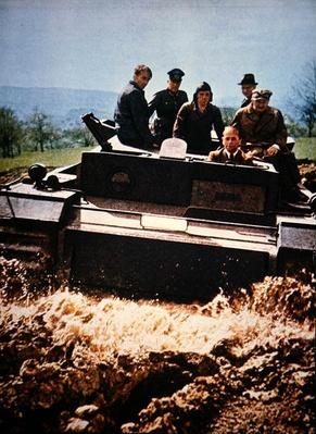 Albert Speer, Reich Minister for War, drives an experimental tank hull over training ground
