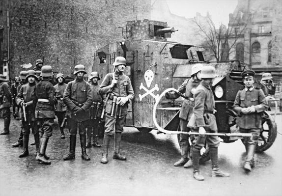 Members of the right-wing Freikorps armed with flamethrower and supported by an armoured car, 1919