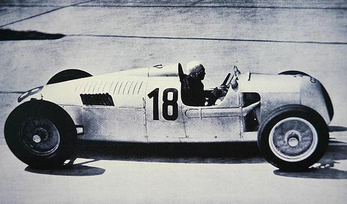Bernd Rosemeyer at speed in a rear-engined 1936/37 Type 'C' Auto-Union Grand Prix model at the Nurburgring, 1937