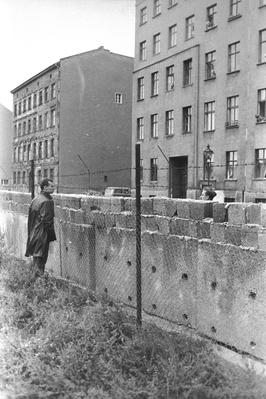 Men Looking Over Berlin Wall | Berlin Wall | The 20th Century Since 1945: Postwar Politics
