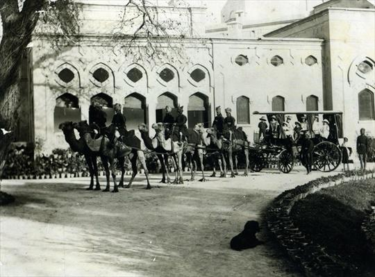 A camel drawn carriage outside Government House, Lahore, c.1900