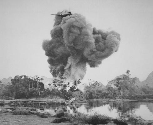 French aircraft drops napalm on Phu Nho Quan, during the French War in Vietnam, 1954