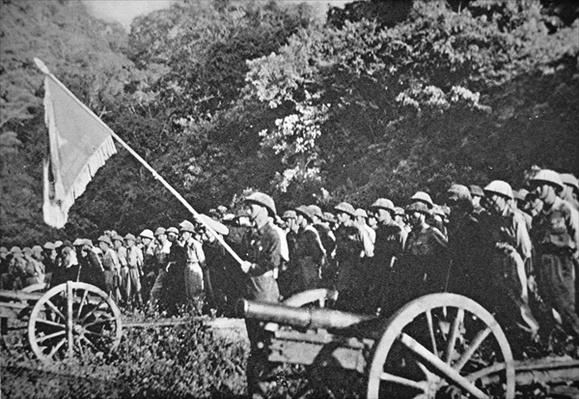 Communist Viet Minh troops on parade with light field artillery, during the siege of Dien Bien Phu, November 1953-May 1954