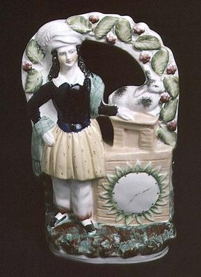 Staffordshire figure of a man with a rabbit, 1840