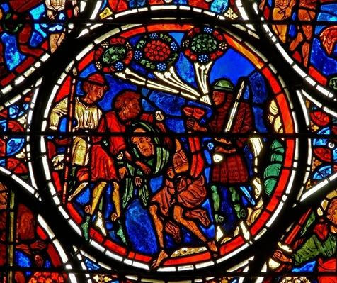 Detail from a window depicting the parable of the Good Samaritan: the man's clothes are stolen