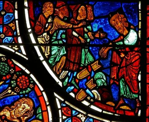 Detail from a window depicting the parable of the Good Samaritan: Moses throws down the tablets