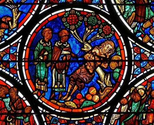 Detail from a window depicting the parable of the Good Samaritan: the priest and Levi pass by