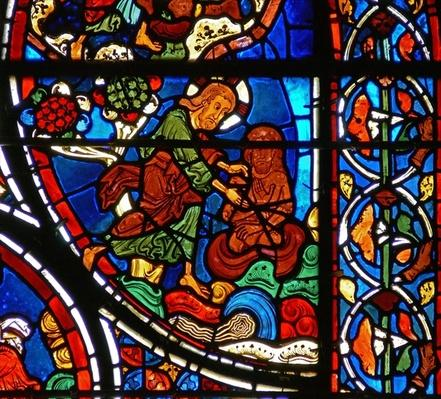 Detail from a window depicting the parable of the Good Samaritan: God creates man from clay