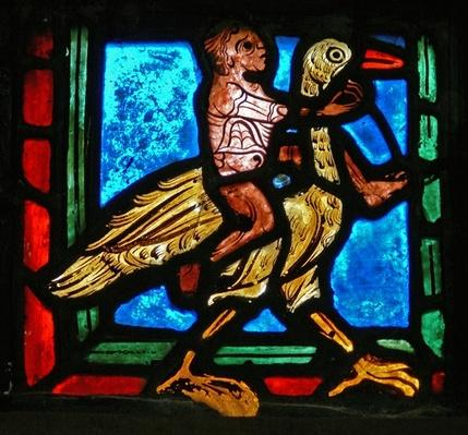 Corner piece from a window depicting the parable of the Good Samaritan: man and bird