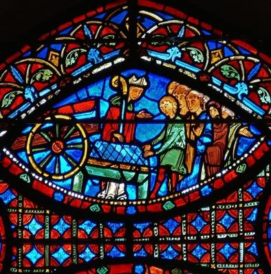 Detail from a window depicting scenes from the life of St. Stephen: bishop and casket