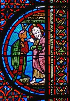 Detail from a window depicting the parable of Lazarus and Dives: the rich man with Christ