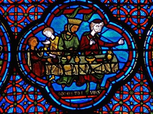 Detail from a window depicting the parable of Lazarus and Dives