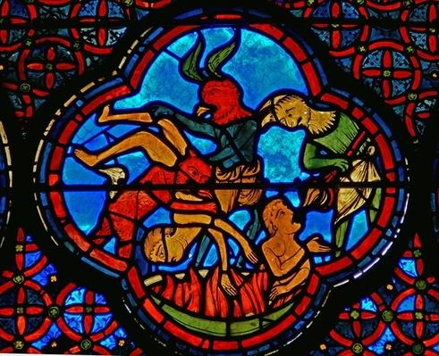 Detail from a window depicting the parable of Lazarus and Dives: the rich man in hell