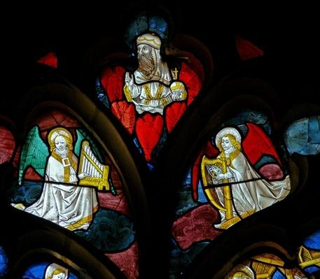 Window depicting musical angels and God