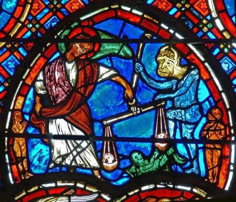 Detail from a window depicting the Last Judgement: St. Michael weighs souls