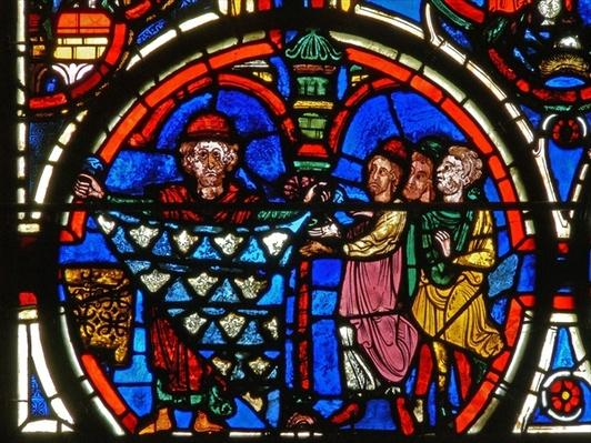 Detail from a window depicting the Passion: donors and the furriers