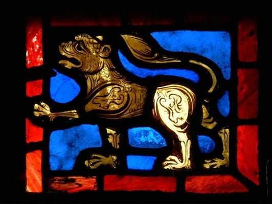 A corner piece depicting a lion, from the Passion window