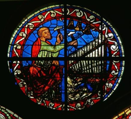 Rosette window depicting an organ and bells