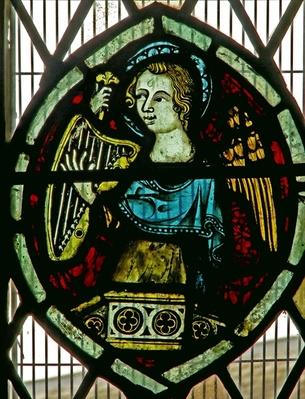 Window depicting an angel playing a harp