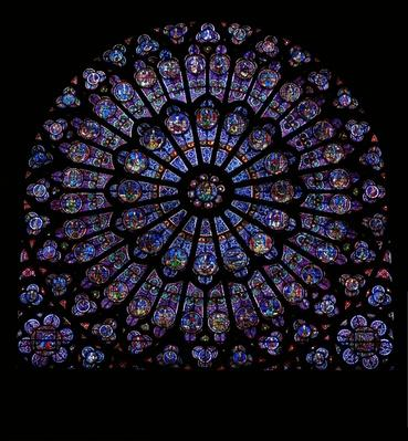 The North Rose window depicting Kings and Prophets surround the Virgin Mary and Infant Christ