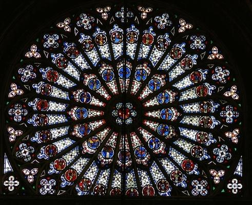 Rose window depicting Christ surrounded by the twelve Apostles and Evangelist symbols
