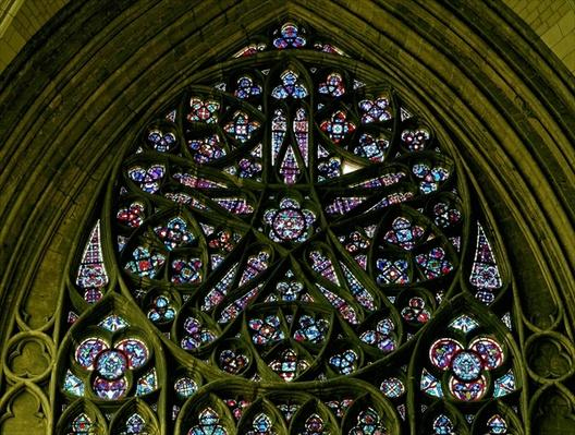 Rose window with nineteenth-century glass after a medieval design