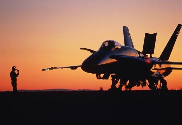 US Navy McDonnell Douglas F/A-18 Hornet silhouetted at sunset | The Evolution of Military Aviation