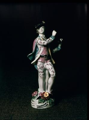 Lowestoft figure of a boy playing a triangle, c.1780