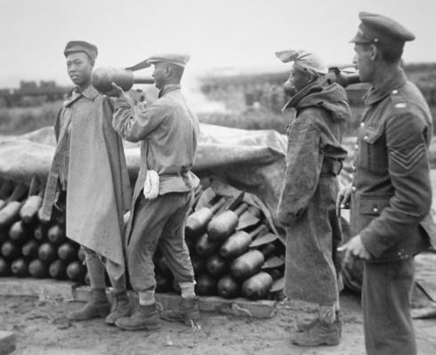 Chinese labourers working for the British Army in France stacking aerial bombs at an ordnance dump in WWI