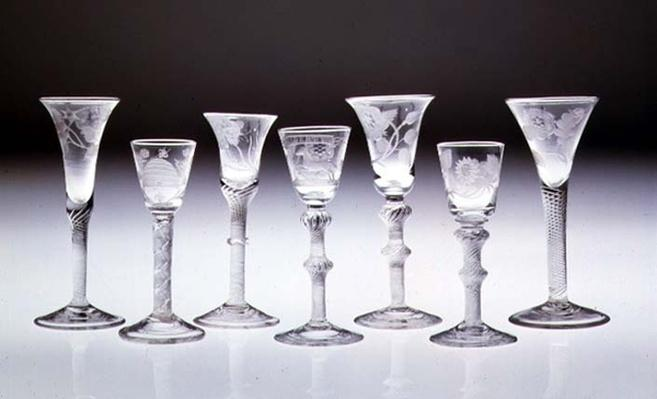 Collection of engraved glasses with opaque and air twist stems