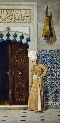A eunuch before the door of the harem