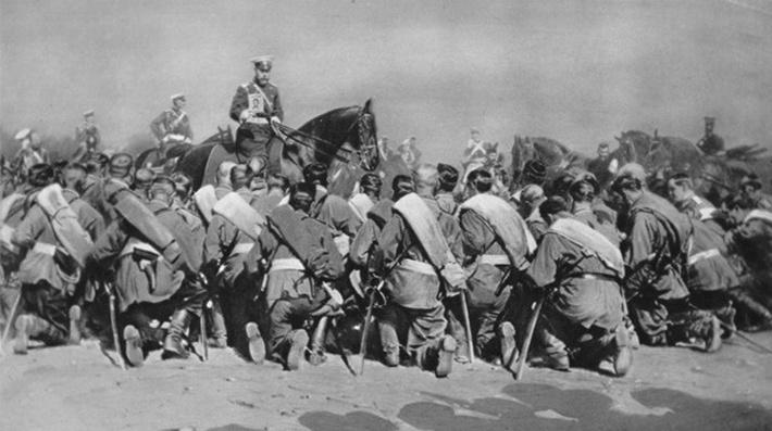 Nicholas II holds an icon before his kneeling troops, from the 'Illustrated War News', 9th September 1914