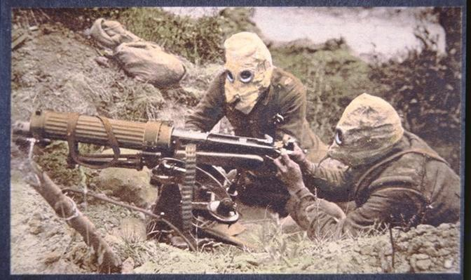 British Vickers machine gun crew on the Some, wearing helmets as protection against German phosgene gas, 1916