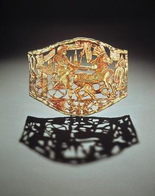 Openwork plaque or buckle showing the king's triumphal return with prisoners, from the Tomb of Tutankhamun, New Kingdom