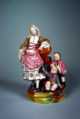 Statuette of a young woman with her two sons