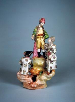 Statuette of four persons grouped on a rockery