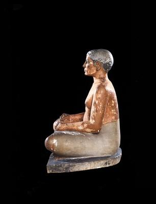 Wide view of Crouching Scribe Statue, from Saqqara, Old Kingdom
