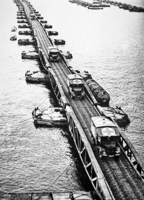 Ambulances of the Allied landing forces using a Mulberry Pier of the Mulberry artificial harbour that had been towed across the channel